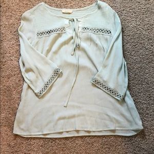 A long sleeve blouse with cutouts